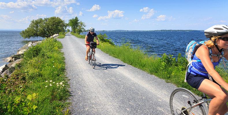 Biking on a trail near the water
