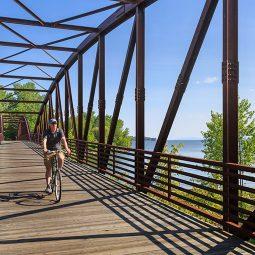 Man riding bike on a bridge