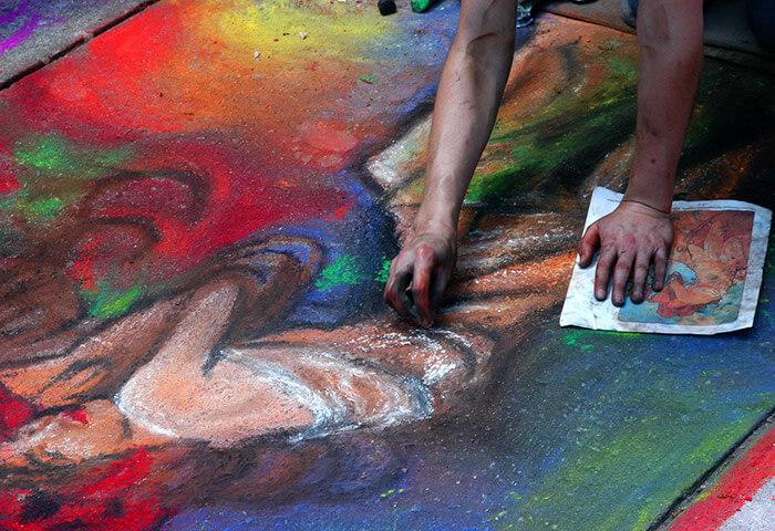 Artist creating chalk art