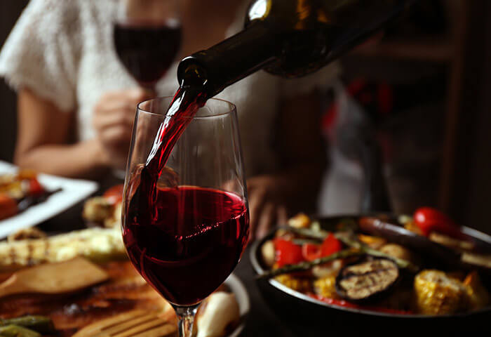 Pouring Red wine with dinner