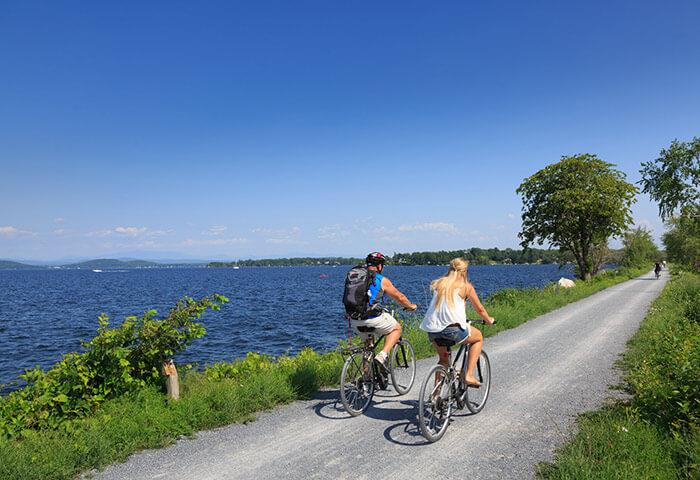 Couple biking near water